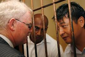 Andrew Chan (right) and Myuran Sukumaran talk to their lawyer.